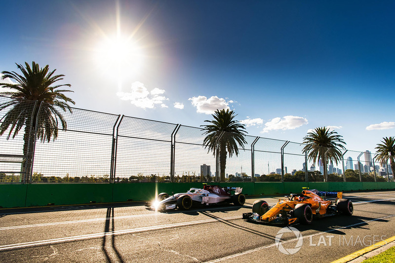 Charles Leclerc, Sauber C37 and Stoffel Vandoorne, McLaren MCL33