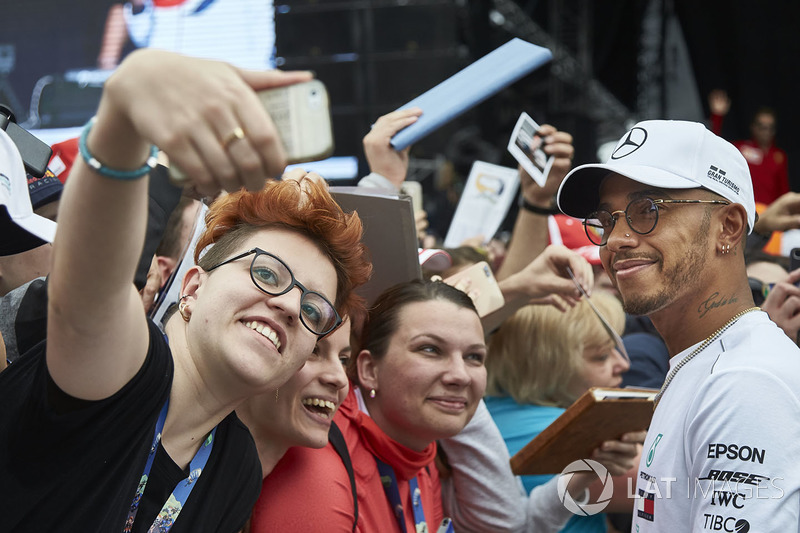 Lewis Hamilton, Mercedes AMG F1, poses for fan to take a picture