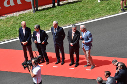 Chase Carey, Chief Executive Officer and Executive Chairman of the Formula One Group and Sean Bratches, Formula One Managing Director, Commercial Operations on the grid
