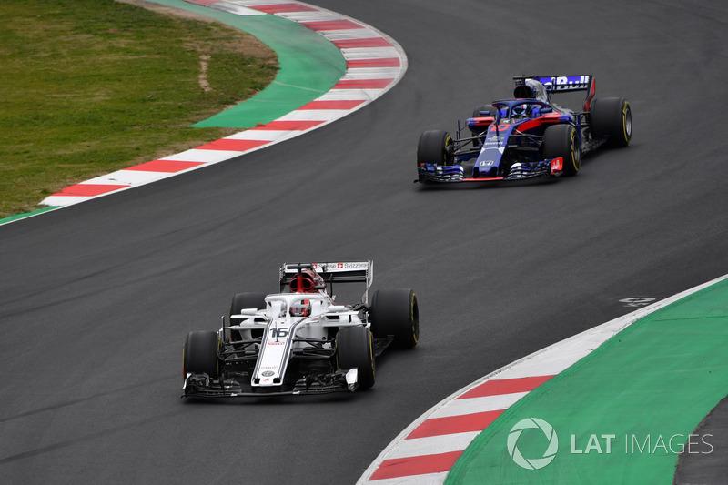 Charles Leclerc, Alfa Romeo Sauber C37 and Pierre Gasly, Scuderia Toro Rosso STR13