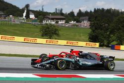 Sebastian Vettel, Ferrari SF71H, battles Lewis Hamilton, Mercedes AMG F1 W09