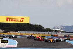 Stoffel Vandoorne, McLaren MCL33, leads Marcus Ericsson, Sauber C37, and Sebastian Vettel, Ferrari SF71H