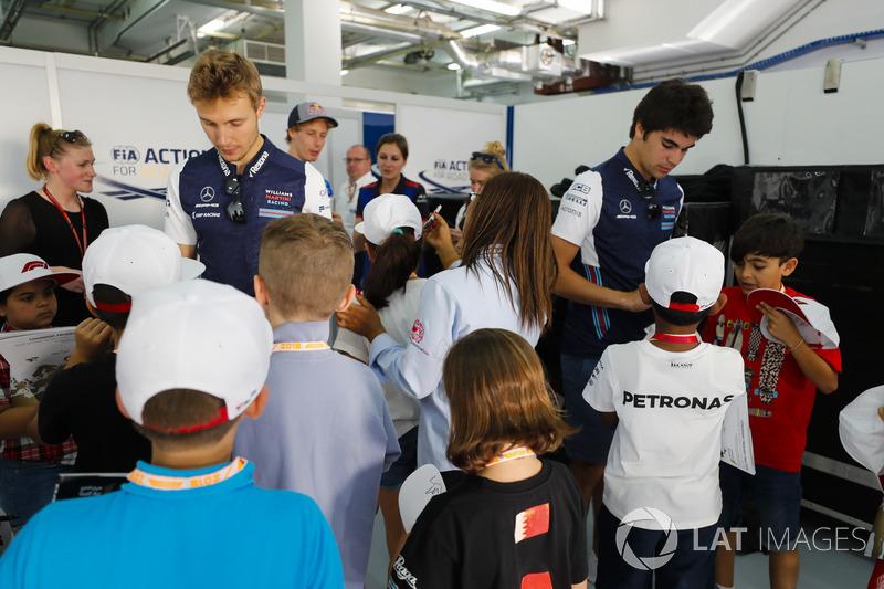 Sergey Sirotkin, Williams Racing, Lance Stroll, Williams Racing, and Brendon Hartley, Toro Rosso, si