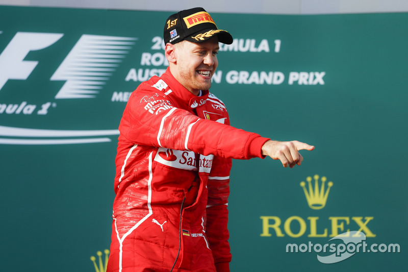 Sebastian Vettel, Ferrari, 1st Position, celebrates victory on the podium
