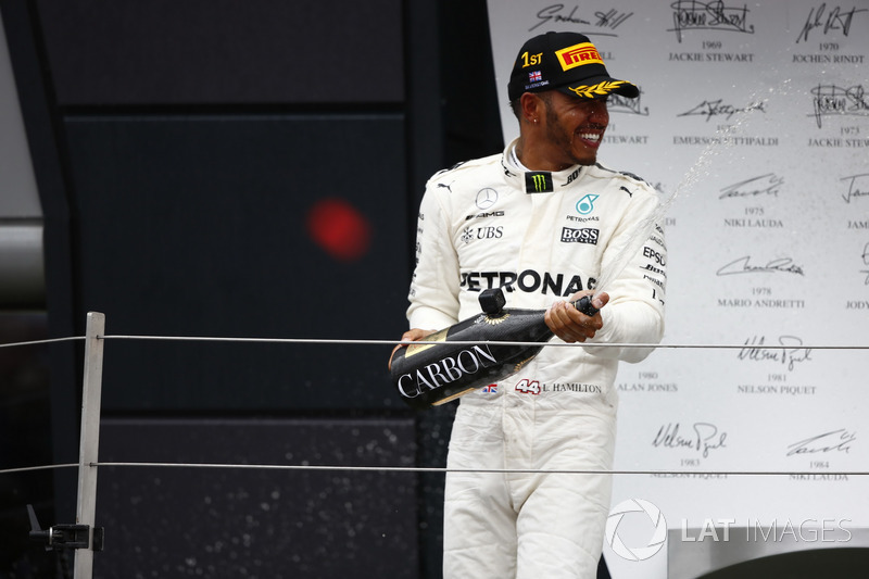 Race winner Lewis Hamilton, Mercedes AMG F1, celebrates with champagne on the podium