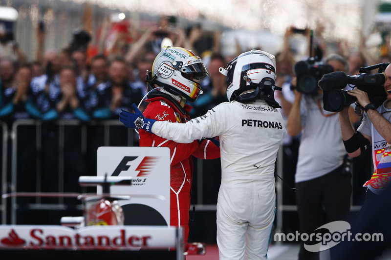 Second place Sebastian Vettel, Ferrari, race winner Valtteri Bottas, Mercedes AMG F1