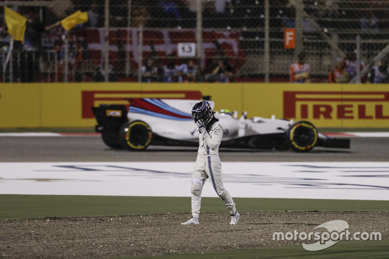 Lance Stroll, Williams FW40, walks away from his damaged car after a collision with Carlos Sainz Jr.