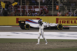 Lance Stroll, Williams FW40, walks away from his damaged car after a collision with Carlos Sainz Jr., Scuderia Toro Rosso