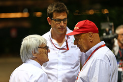 (L to R): Bernie Ecclestone, with Toto Wolff, Mercedes AMG F1 Shareholder and Executive Director and