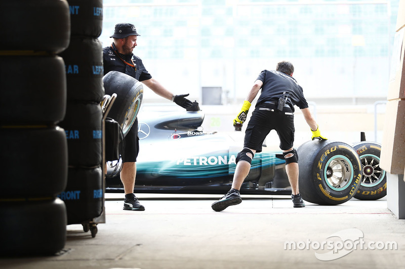 Mercedes team members in the pits