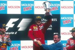 Podium: race winner Jean Alesi, Ferrari, second place Rubens Barrichello, Jordan, third place Eddie Irvine, Jordan, Pierre Bourque, Mayor of Montreal