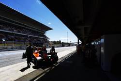 Fernando Alonso, McLaren MCL32, is returned to the garage