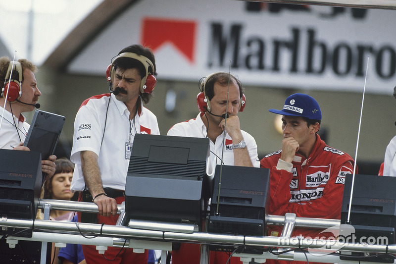 Ayrton Senna and Ron Dennis, on the McLaren pit gantry with Gordon Murray