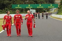 Inaki Rueda, Ferrari Race Strategist, Antti Kontsas, trainer to Sebastian Vettel, Ferrari and Jock Clear, Ferrari Chief Engineer walk the track