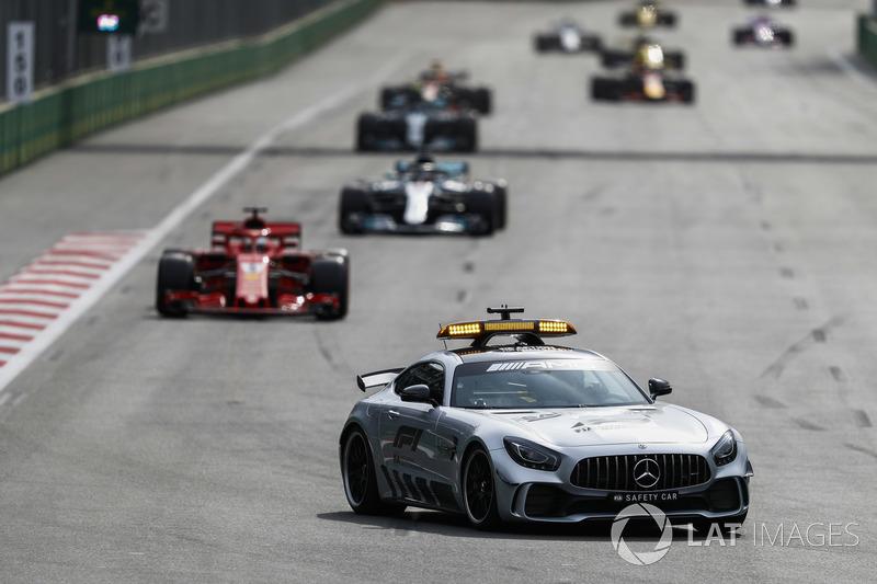 The Safety Car leads Sebastian Vettel, Ferrari SF71H, Lewis Hamilton, Mercedes AMG F1 W09, and Valtteri Bottas, Mercedes AMG F1 W09