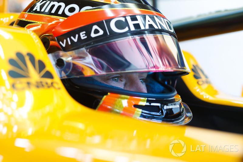 Stoffel Vandoorne, McLaren, in cockpit with helmet visor raised.