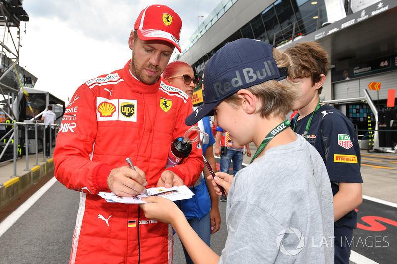 Sebastian Vettel, Ferrari signs autographs