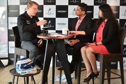 Mika Hakkinen with Kunal Shah and Mithila Mehta