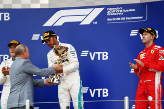 Vladimir Putin, President of Russia, presents Race winner Lewis Hamilton, Mercedes AMG F1, his trophy