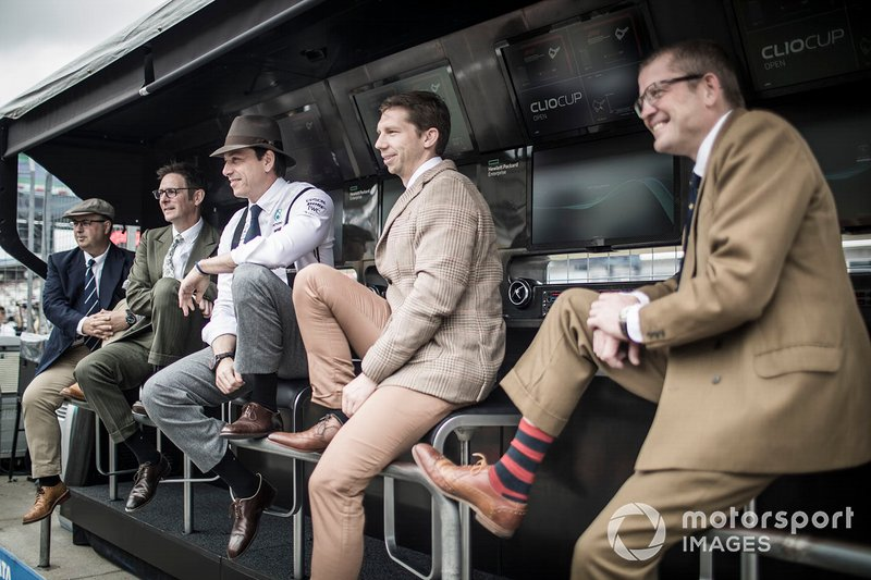 Mercedes AMG staff on the pit wall in 1950s style clothing