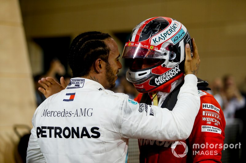 Lewis Hamilton, Mercedes AMG F1, 1st position, talks with Charles Leclerc, Ferrari, 3rd position, in Parc Ferme