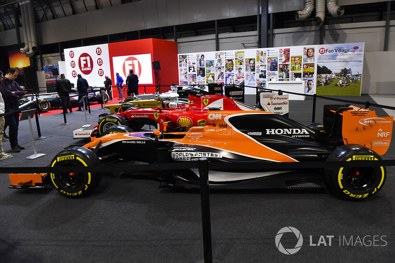 A line-up of cars, including a McLaren and Ferrari, on the F1 Racing Stand