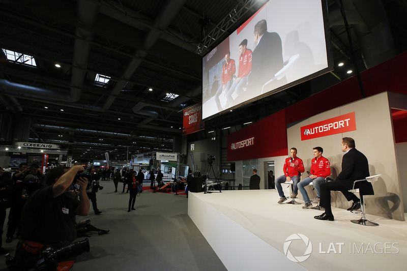 Kris Meeke and Craig Breen of Citroen meet Henry Hope-Frost on the Autosport Stage