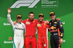 (L to R): Valtteri Bottas, Mercedes-AMG F1, Sebastian Vettel, Ferrari and Max Verstappen, Red Bull Racing celebrate on the podium