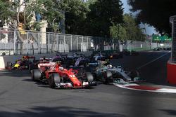 Kimi Raikkonen, Ferrari SF70H, Valtteri Bottas, Mercedes AMG F1 W08 at the start of the race