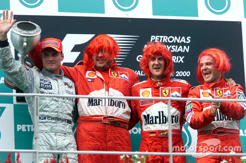 Подіум: друге місце Девід Култхард, McLaren; Росс Браун, Ferrari; переможець гонки Міхаель Шумахер,