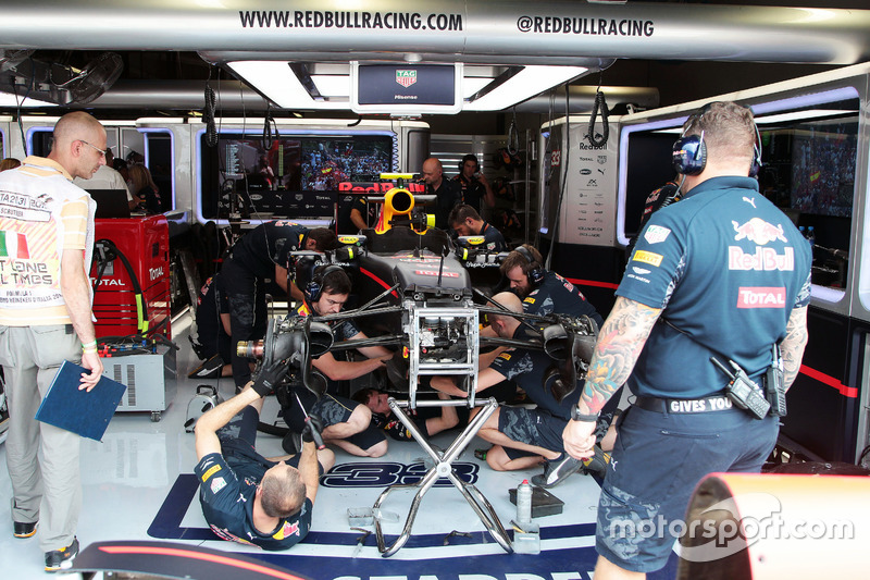 Red Bull Racing mechanics work on the Red Bull Racing RB12 of Max Verstappen,