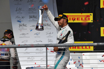 Lewis Hamilton, Mercedes AMG F1 celebrates with the trophy and the champagne on the podium