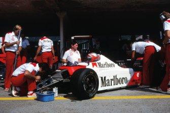 John Watson, McLaren MP4, in the pits