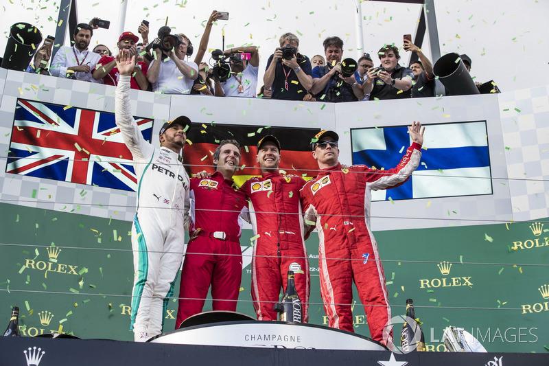 Lewis Hamilton, Mercedes-AMG F1, Inaki Rueda, Ferrari Race Strategist, Sebastian Vettel, Ferrari and Kimi Raikkonen, Ferrari celebrate on the podium