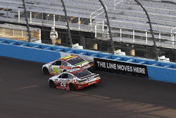 Matt Kenseth, Joe Gibbs Racing Toyota passes Chase Elliott, Hendrick Motorsports Chevrolet for the lead