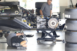 Crewmembers working on the car of #55 Mazda Team Joest Mazda DPi: René Rast, Oliver Jarvis