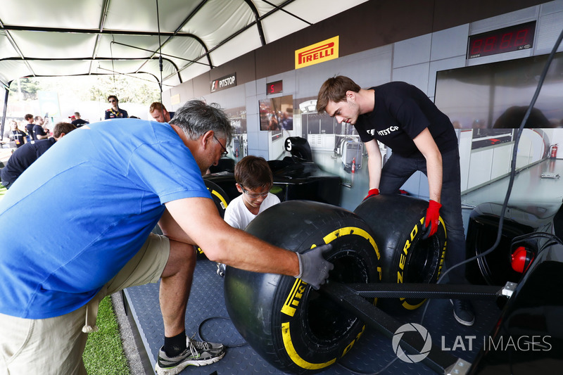 Fans take part in the pit stop challenge in the F1 Fanzone
