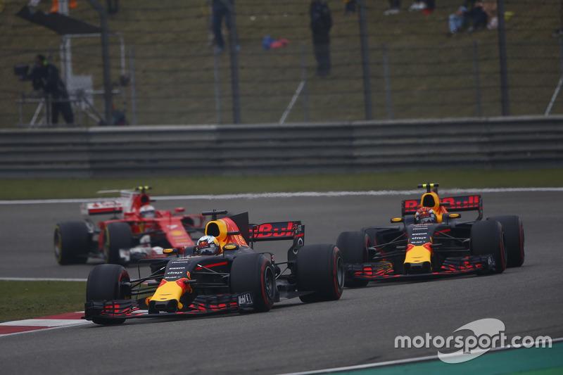 Daniel Ricciardo, Red Bull Racing RB13, leads Max Verstappen, Red Bull Racing RB13, and Kimi Raikkon