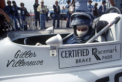 Gilles Villeneuve, March 76B-Ford BDA, in an early helmet design sits in his cockpit