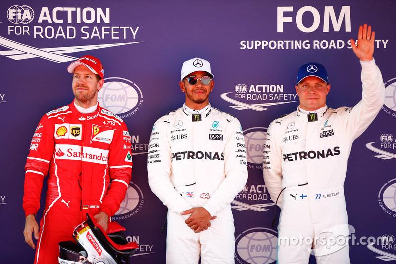 Polesitter Lewis Hamilton, Mercedes AMG F1, second place, Sebastian Vettel, Ferrari, third place Val