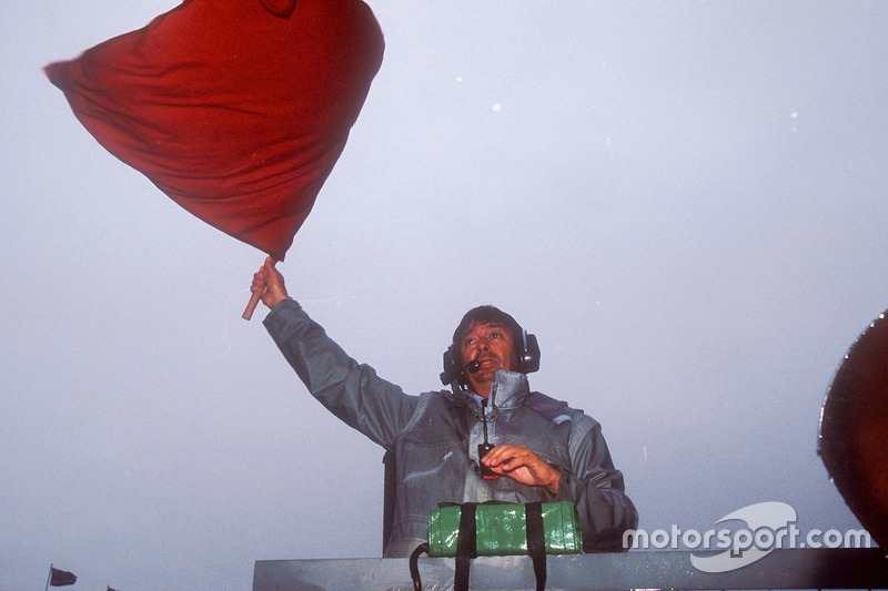 FIA Race Starter Roland Bruynseraede waves the red flag to stop the race after 15 laps, due to the torrential rain that made driving conditions attrocious