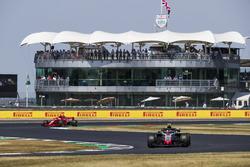 Kevin Magnussen, Haas F1 Team VF-18, leads Sebastian Vettel, Ferrari SF71H
