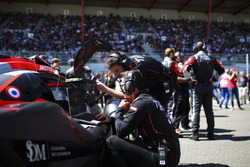 Mechanics and engineers at work on the grid
