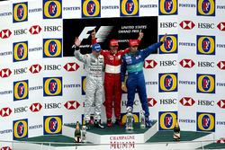 Podium: second place Kimi Raikkonen, McLaren, Race winner Michael Schumacher, Ferrari, third place H