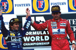 Podium: Race winner Ayrton Senna, McLaren, second place and World Champion Alain Prost, Williams