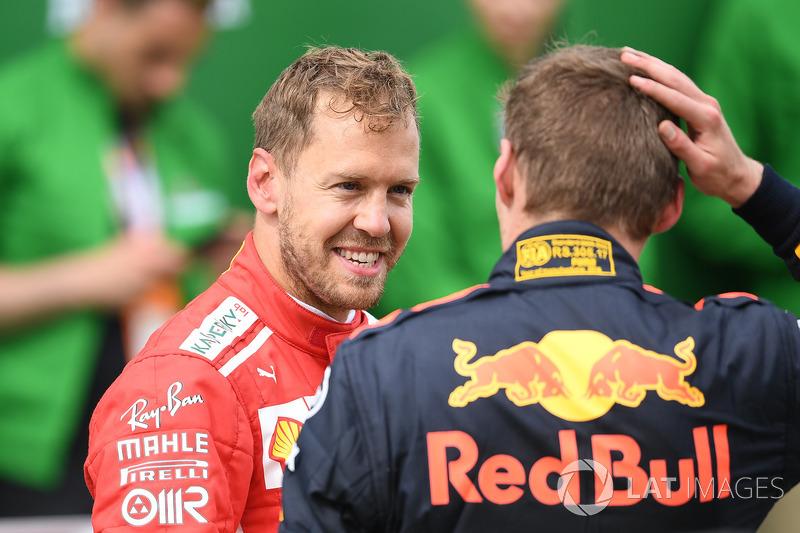 Sebastian Vettel, Ferrari y Max Verstappen, Red Bull Racing en parc ferme