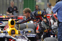 Sebastian Vettel, Red Bull Racing RB7 Renault, celebrates pole in Parc Ferme