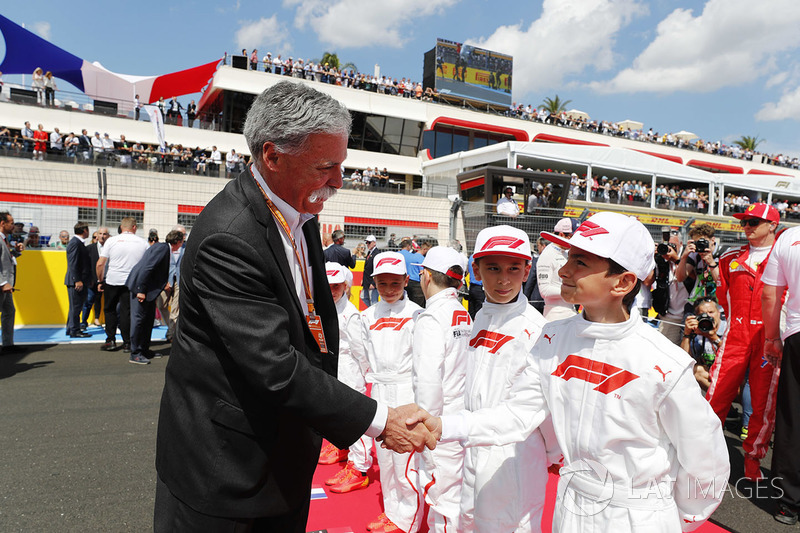 Chase Carey, Chairman, Formula One, meets the Grid Kid mascots