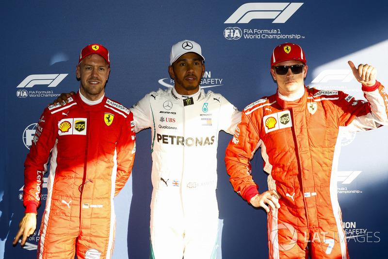 Lewis Hamilton, Mercedes AMG F1, celebrates taking pole position between Kimi Raikkonen, Ferrari, and Sebastian Vettel, Ferrari