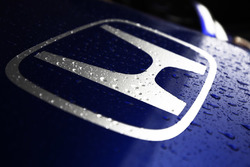 Rain drops on a Honda logo on the nose of the Toro Rosso STR13 Honda